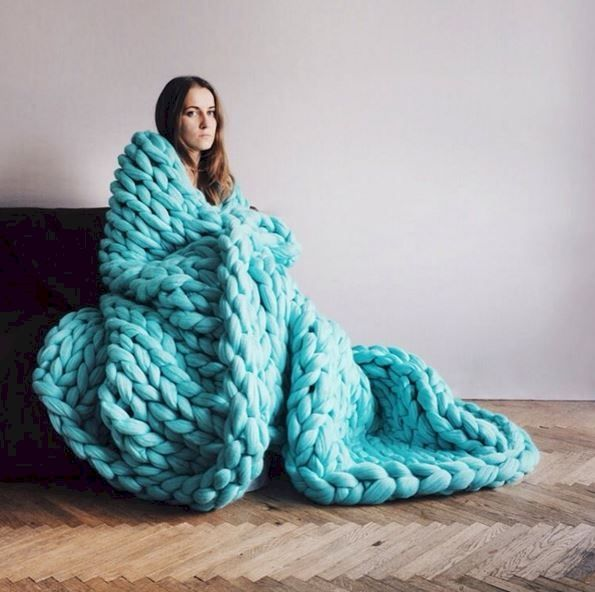 Make a gigantic knit blankie. While you're at it, I'll find you Lilly Tomlin's great big chair  ya