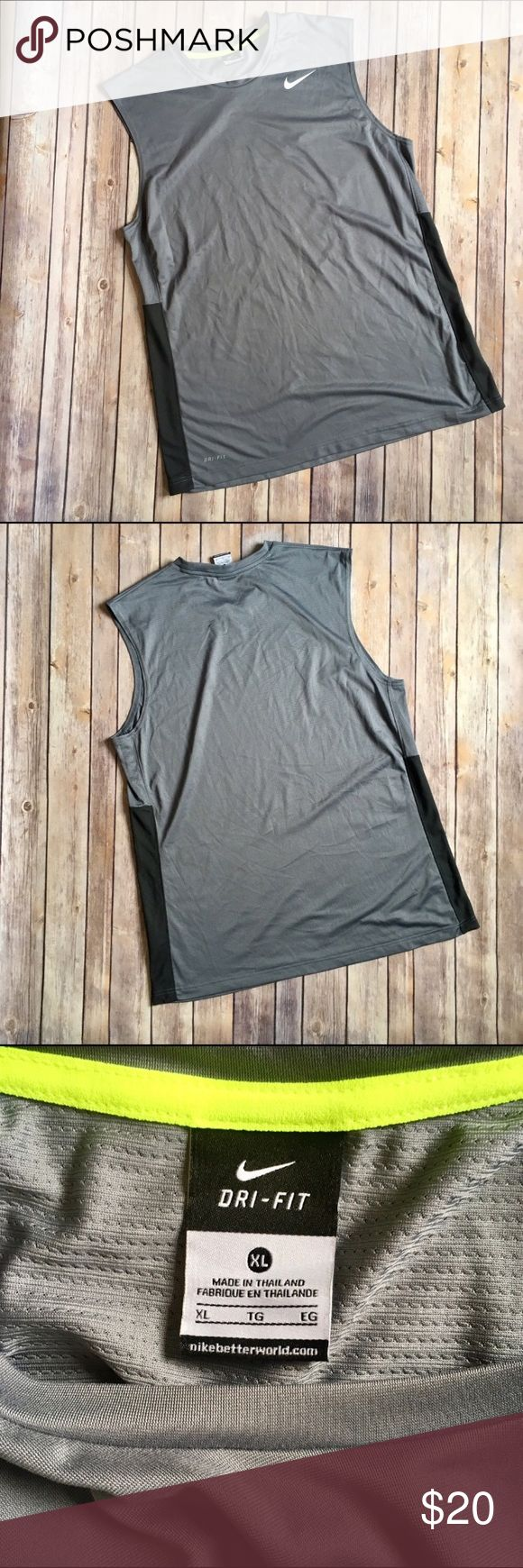 NIKE DRIFIT Men's Grey Muscle Shirt This men's Nike DriFit muscle shirt has a mesh back for comfort and style. Grey with black side panels.  Nike swoosh is white and in perfect shape, intact with no cracking or peeling.   Size XL (Men's)  No stains, snags, runs, holes. Nike Shirts Tank Tops