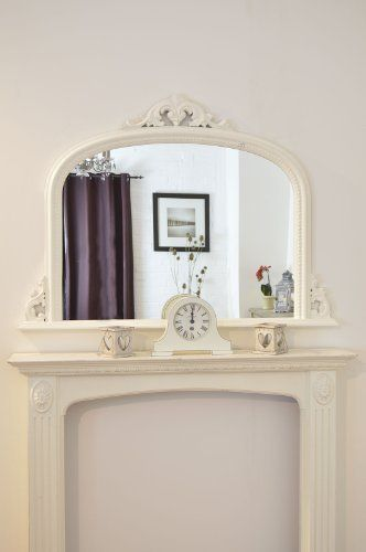 Arched mirror and cream mantel clock