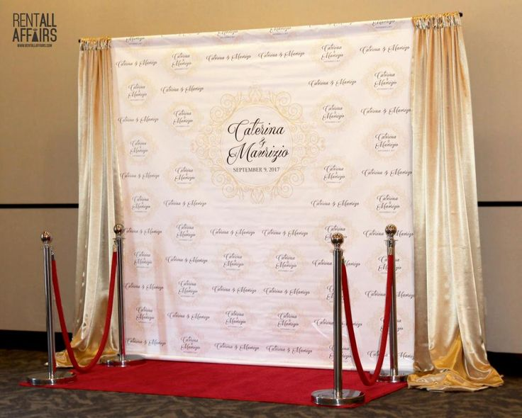 Create a custom backdrop for your photo booth feature. Treat your guests like celebrities on the red carpet.