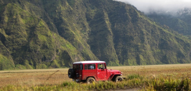 This red hardtop is one of the four-wheel drives you take to reach Mount Bromo from Cemorolawang to Pananjakan then on to the sand sea caldera. Photo by Andika Saputra - www.indonesia.travel