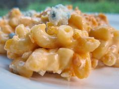 Buffalo Chicken Mac and Cheese --- pasta and chicken tossed in a creamy homemade buffalo cream sauce and baked to perfection. Crazy good!! You can leave out the bleu cheese if you don't like it.