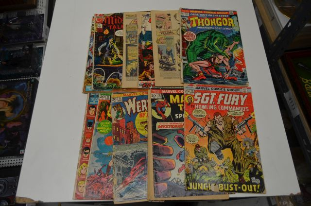 Marvel comics lot containing comics Such as, Sargent fury, werewolf by night, Justice League America, outlaw kid