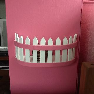 DIY Barbie doll house balcony. My husband came up with this great idea. He found an old basket at the DI cut it in half painted it and glued and screwed lol it onto the doll house... So clever