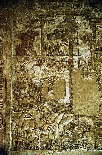 Attendants greeting king Akhenaten, who sits Under a shrine-like dais, in his palace of Akhetaten. 18th dynasty.