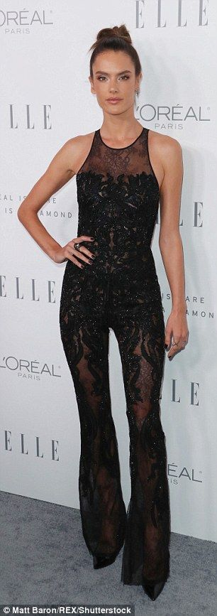Top of the knots! The Brazilian supermodel, 36, showed off her supermodel statistics in a glitzy semi-transparent jumpsuit as she attended the star-studded event