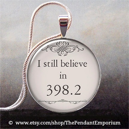 """""""I still believe in 398.2"""" The fairy tale section for the Dewey Decimal System -- for fairy tale lovers, librarians and book geeks everywhere! Handcrafted pendant 1"""" across (25.4mm). © The Pendant Emporium on Etsy."""