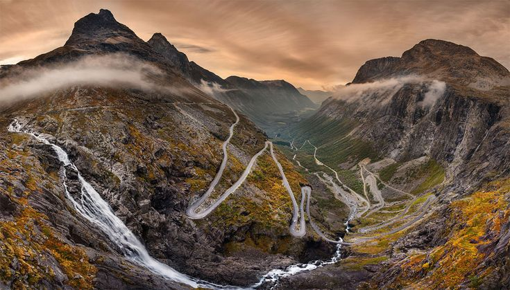 Trollstigen is a serpentine mountain road in Rauma Municipality, Møre og Romsdal county, Norway. It is part of Norwegian National Road 63 that connects the town of Åndalsnes in Rauma and the village of Valldal in Norddal Municipality