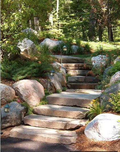 Solar path lights are ideal for illuminating walkways far from exterior outlets, and can provide an enchanting glow along winding garden paths. (These steps are perfect!)