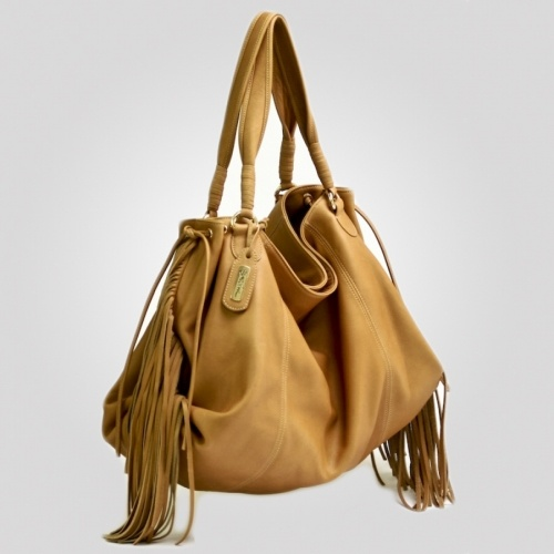 "Olivia Fringe: A large slouchy tote of supple deerskin with lovely detailing, and fringed sides. Double handles, envelope side closure with Italian golden hardware including golden dog clips, and magnetic closure. Just a little ""rock star."" $355"