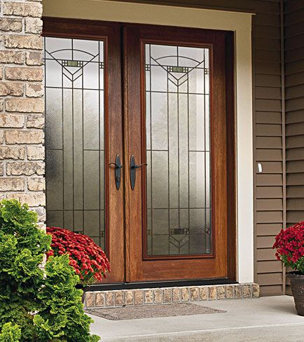 A decorative door glass such as the Greenfield by ODL can add another layer of updated design to your home.  Though designated a Craftsman door, it is muted enough to grace other architectural styles as well. Another positive is that it is also severe weather rated.  Note-Be sure to get  a glass door with a privacy level you are comfortable with-this door rates 7 out of 10 on privacy.