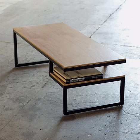 Coffee table with storage component, in walnut ply on a black steel base, from Gus* Modern.
