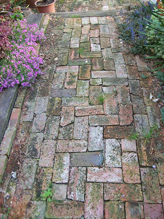 Basic brick path. Make it slope down slightly (like a dome) and note the edge brick - raised to act as a gutter for rain drainage.