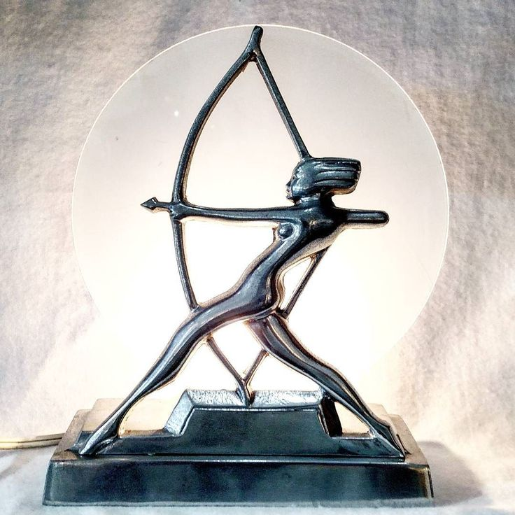 Deco sculpture in cast aluminum glass and light. Featuring #Artemis the Huntress. . . . #huntress #diana #greek #deco #accentlighting #sculpture #aluminum #aluminium #decostyle #greekgoddess #archer #antiques #vintagebooth  #vintageshop #vintage #portlandvintage #pdxvintage #vintagepdx #vintageportland  #beaverton #curiositiesvintage