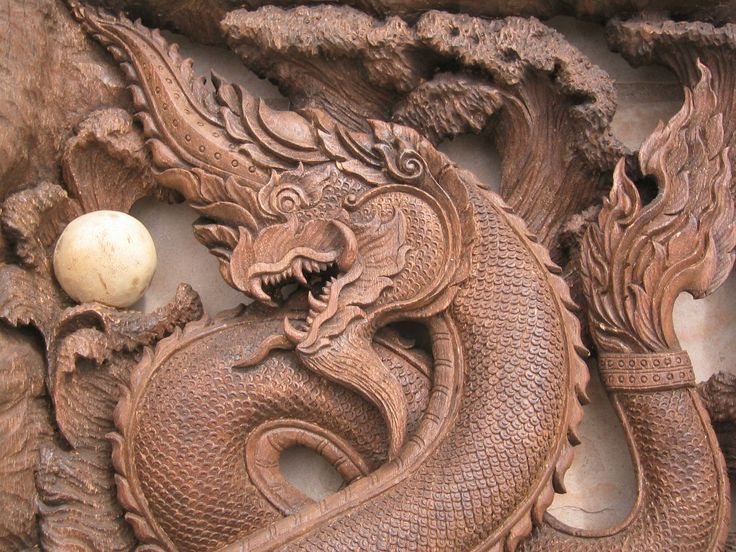 Thai Naga carving. The detail on the tail is a good example for what I have in mind.