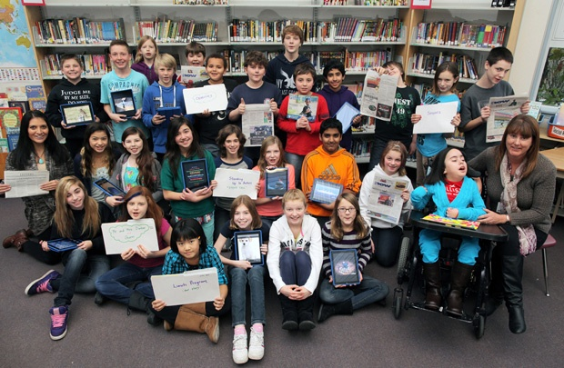 """Students from Ms. Pesce and Mrs. Brister's Grade 6/7 class at Latimer Road Elementary school in Cloverdale are excited to be sitting in the editor's chair next week. Editor Beau Simpson has been visiting the class once a week since early November and has been helping the young journalists hone their skills for a special edition of the 'Now' on Dec. 24. In that issue, the newspaper will be filled with the students' stories, photos, poems and artwork. """"They have been working very hard on their…"""