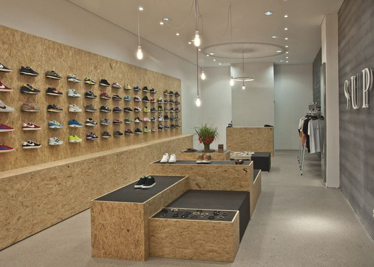 Shoes balanced on bolts and bitumen in chunky chipboard sneaker shop by Daniele Luciano Ferrazzano.
