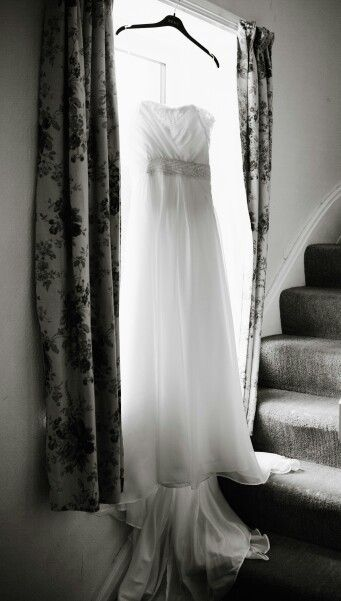 A chiffon dress and the sun shining through the window shows the pattern on the knitted belt.