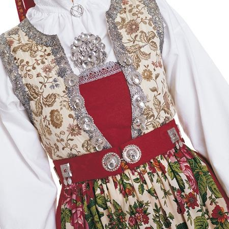 The breast band is pinned to vest with fancy silver pins (Details from the wedding costume, Hallingdal)