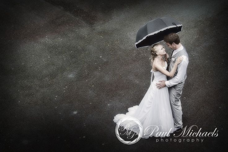Bride and groom in the rain after the ceremony. PaulMichaels Wellington wedding photography http://www.paulmichaels.co.nz/