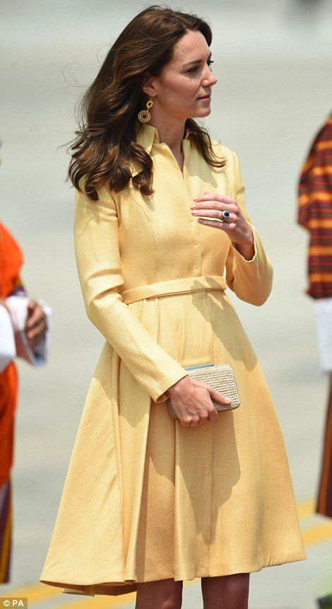 Fashion favourite: Kate opted for a pale gold coat dress by designerEmlia Wickstead for her flight from India on April 14, 2016