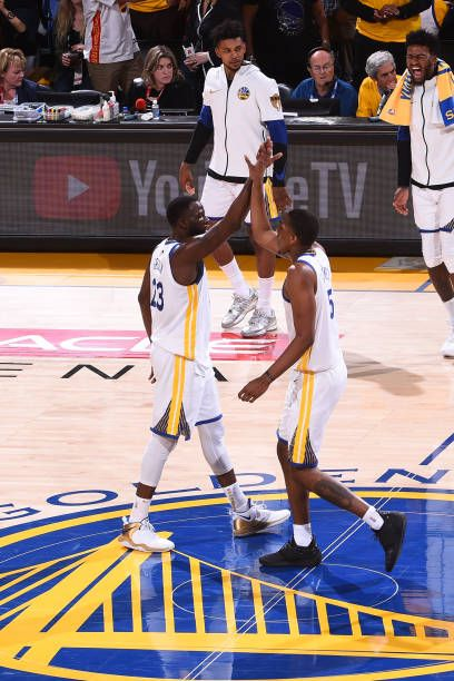 7d2781e16c5a8 Kevin Durant and Draymond Green of the Golden State Warriors high five  during the game against the Cleveland Cavaliers in Game One of the 2018 NBA.