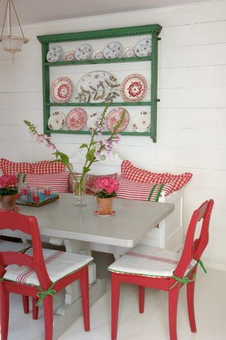 I love the combo of fresh green shelves, gingham pillows, and red chairs.
