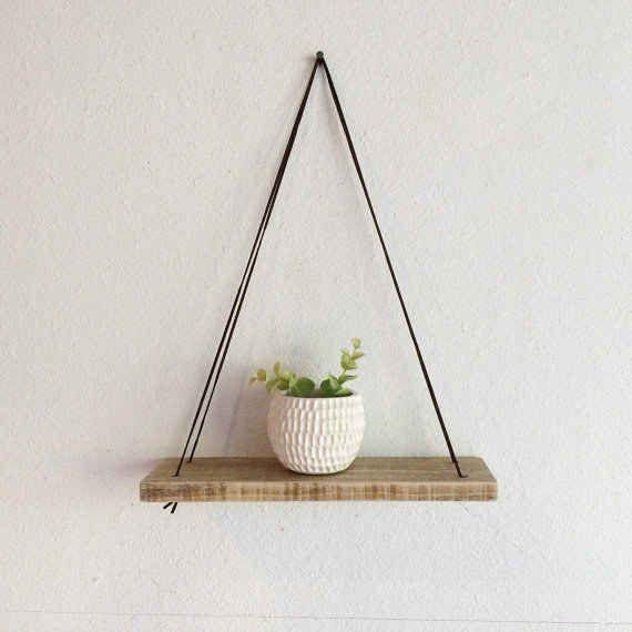 Display your plants on a minimalist hanging shelf.