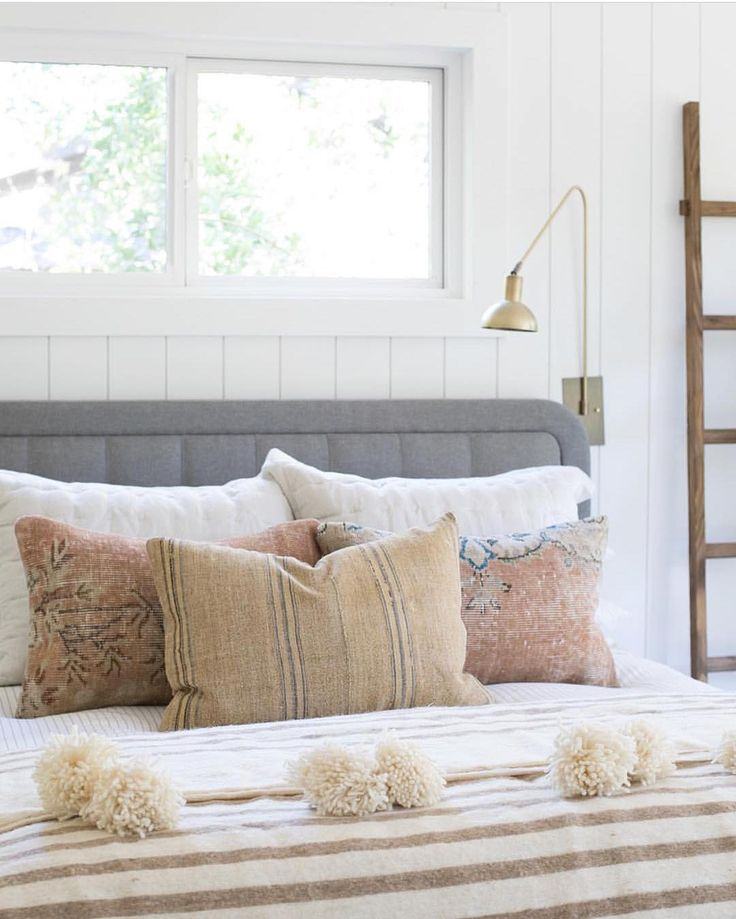 Neutral Bedding with Pom Poms - pinned by www.youngandmerri.com