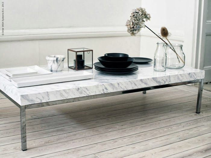 IKEA HACKS  DIY Marble Coffee Table Coming in at number three, this marble coffee table idea from the folks at Livet Hemma. Using the KLUBBO Coffee Table, marble-style contact paper is applied giving it a faux marble top look. More info here.