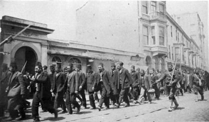 Servants from the deposed Sultan Abdulhamid II's Palace at Yildiz being escorted by soldiers of the Young Turks (CUP) during the April Revolution