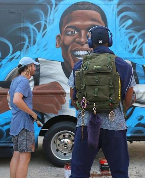 Cam Newton standing in front of his food truck, Smokin' Aces