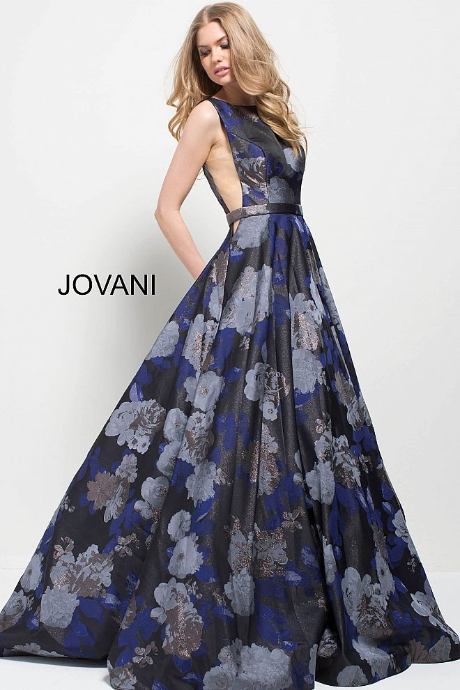 Floor length A-line pleated navy floral print brocade dress with pockets features sleeveless bodice with boat neckline and open back.