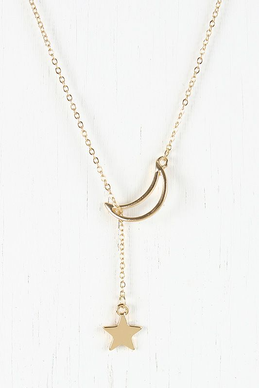 Delicate Night Necklace Featuring gold-tone curb link chain with moon and star charm. Lead and nickel free. $8
