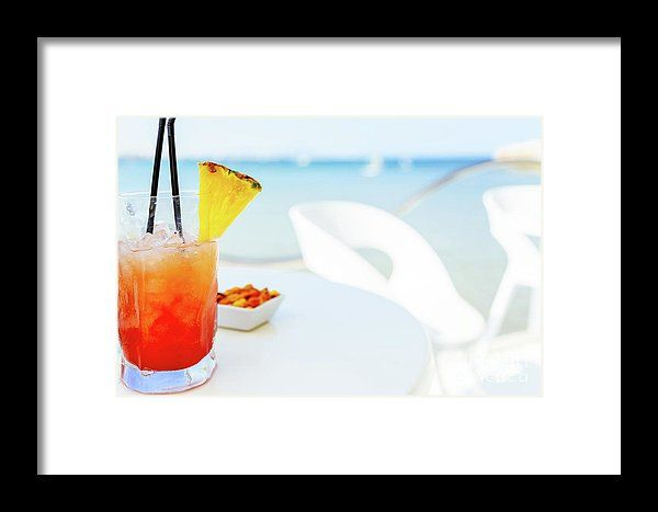 Fresh Red And Orange Cocktail Glass In Summer With Ocean Background Framed Print