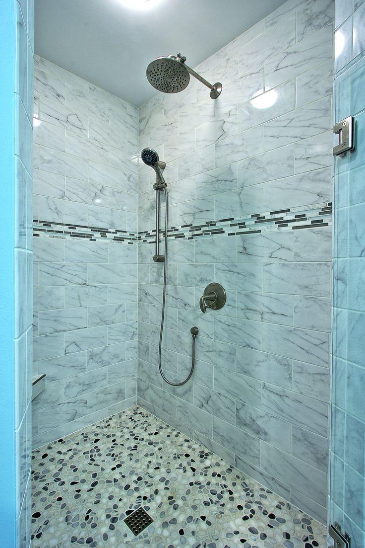 Custom Tiled Shower With Porcelain Tiles That Look Like Marble, Pebbles On  The Shower Floor