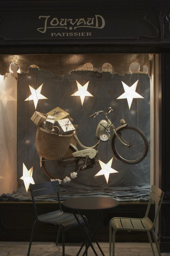 """From Provence, """"Jouvaud Patissier"""" whimsical store window display with flying bicycle, Carpentras, France #retail"""