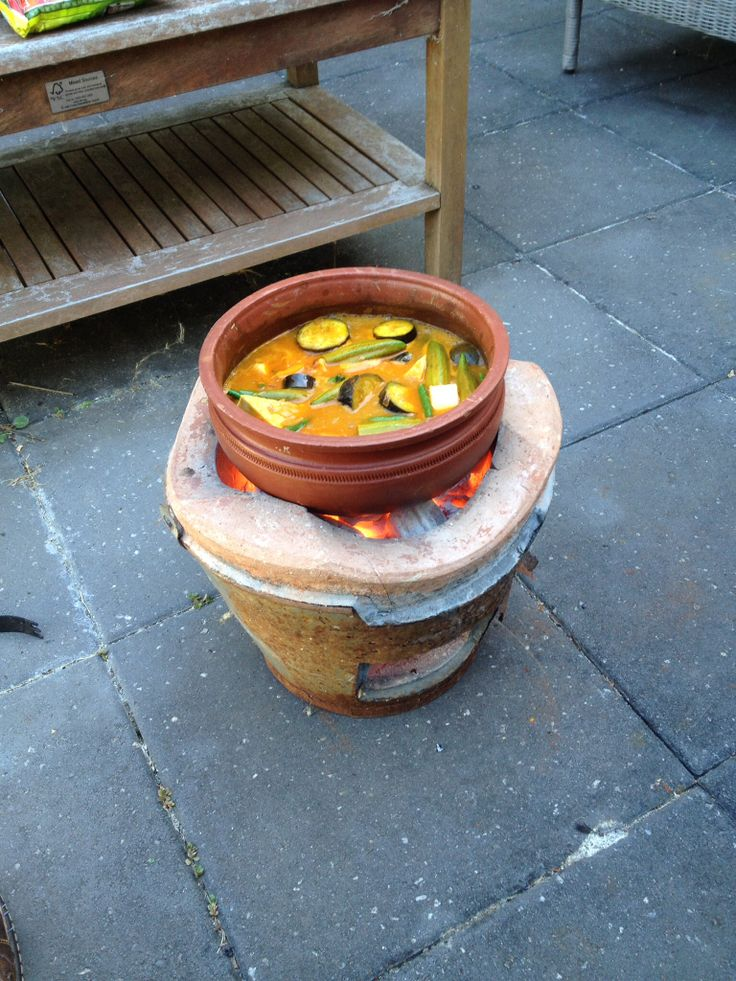 Clay pot red curry cooked on hot coals.