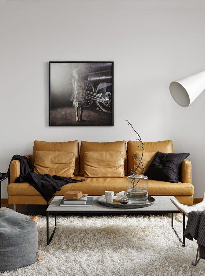 Sofá de cuero bronceada en estilo escandinavo salón
