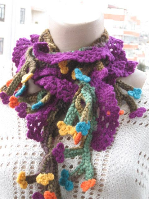 Long crochet scarf with flowers on it. Multi by HUCHIDESIGNS, $35.00
