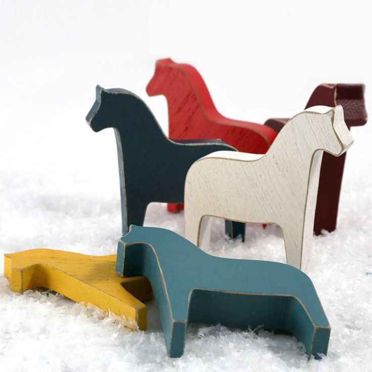 Use these simple but timeless figurines to decorate your house for Christmas or as a natural wooden toys for kids to play.Set of six horses. Each horse is of a different color: white, yellow, blue, red, burgundy and navy.Each horse is also available