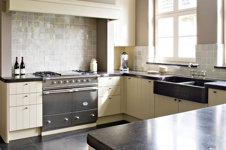 Stainless steel Lacanche Cluny range with a traditional cooktop & cover