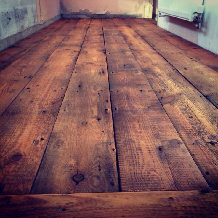 Reclaimed pine flooring fitted in barn conversion in Carmarthen