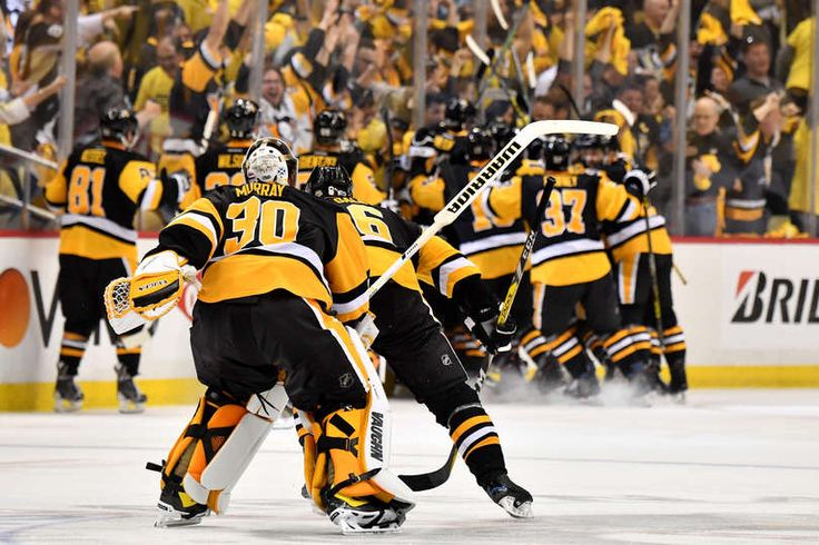 PITTSBURGH, PA - MAY 25: The Pittsburgh Penguins celebrate after Chris Kunitz #14 scored the game winning goal agianst Craig Anderson #41 of the Ottawa Senators in the second overtime with a score of 3 to 2 in Game Seven to win the Eastern Conference Final during the 2017 NHL Stanley Cup Playoffs at PPG PAINTS Arena on May 25, 2017 in Pittsburgh, Pennsylvania. (Photo by Jamie Sabau/Getty Images)
