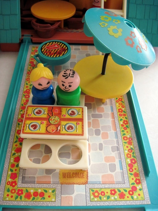 Fisher Price Little People   Close up of the opened A-Frame dollhouse showing the patio area