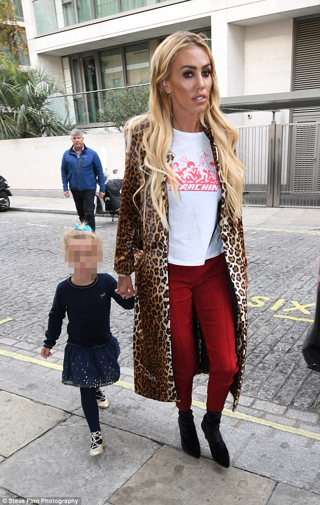 First outing:Petra Ecclestone has made her first public appearance since her acrimonious divorce from James Stunt as sheattended her father Bernie Ecclestone's 87th birthday party at London's Zuma restaurant on Saturday with daughter Lavinia