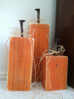 2 x 4 wood pumpkins with railroad spike stems