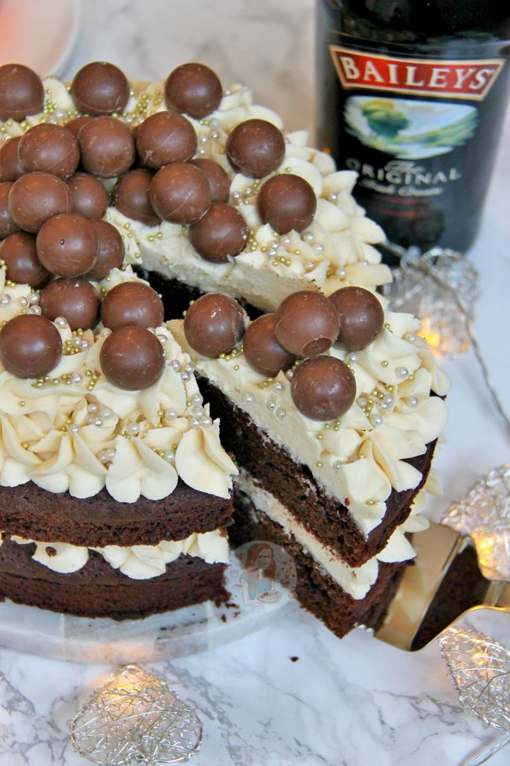 A Two-Layer Chocolate Fudge Cake with Baileys Buttercream, and Baileys Truffles. The MOST Delicious Baileys Cake Ever! One thing that I have been craving for...