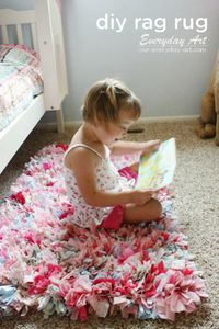 Looking for an easy homemade holiday gift idea for your little girl or boy's bedroom? This simple DIY rag rug is the perfect addition to your toddler's bedroom or playroom —especially as a cozy reading spot where they can enjoy their favorite kids' books!