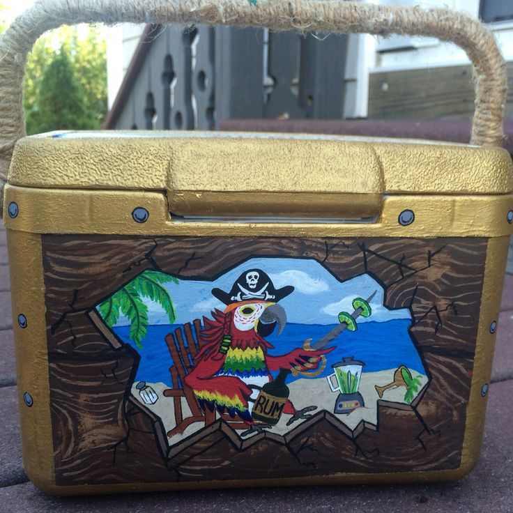 Back view of my cooler turned treasure chest, I wrapped rope around the handle for an added effect.  This is one of my all time favorites. #paintedcooler #fraternity #treasurechest #woodcooler #forguys #margaritaville #parrot #tropical #beach #craft #coolerideas